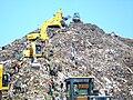 Mountain of garbage in Bantar Gebang with some excavator.jpg