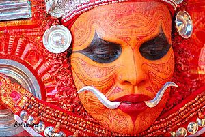 "Thalassery - ""Mukathezhuthu""-The face painting of Theyyam, the religious ritual art form in Thalassery"