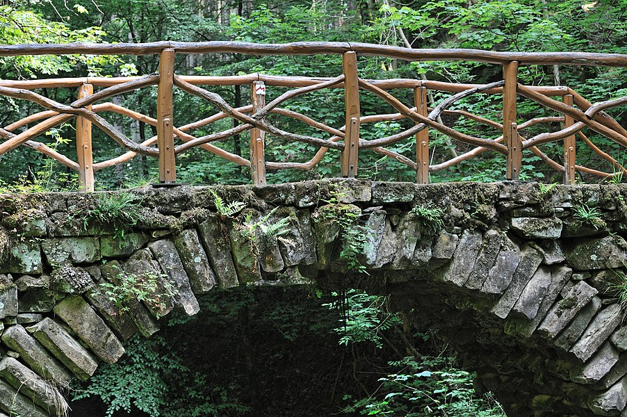 Luxembourg Mullerthal, Little Switzerland: detail of the bridge over the Ernz noire-waterfall (Schiessentümpel.