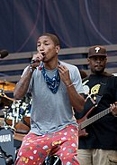 Pharrell Williams singing onstage.