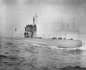 USS D-3 underway off New York City during the October 1912 Naval Review. USS Kearsarge (BB-5) is in the background