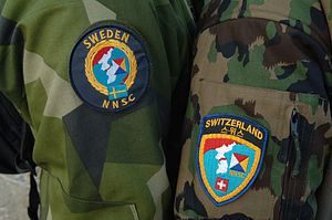 Neutral Nations Supervisory Commission - Uniform patches worn by NNSC delegates from Sweden and Switzerland