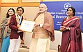 Narendra Modi presenting the National Bravery Awards 2015 to the children, in New Delhi on January 24, 2016. The Union Minister for Women and Child Development, Smt. Maneka Sanjay Gandhi is also seen (6).jpg