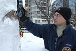 Navy Misawa snow sculpture team begins shaping 'The Lone Sailor' 120201-N-ZI955-182.jpg