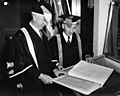 Norman MacKenzie and Sherwood Lett examining Roll of Service - Canada - 1955.jpg