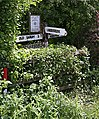 Overgrown signpost in Ford village, nr Salisbury - geograph.org.uk - 189893.jpg