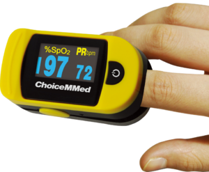 English: A finger mounted pulse oximeter with ...