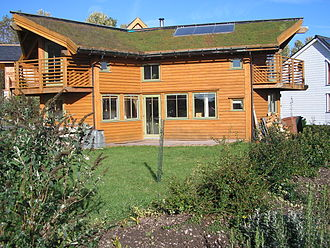 An eco-house at Findhorn Ecovillage with a turf roof and solar panels PA120016.JPG