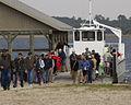People Unloading On St Vincent Refuge For Open House By George Burton.jpg