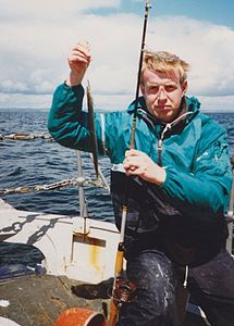 Peter van der Sluijs with a sand eel caught in Ireland.jpg