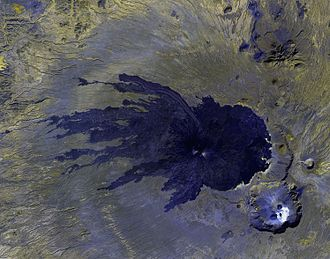 Satellite image of the more recent lava rock, in black, with Tousside volcano (center) and the Trou au Natron crater (bottom right) Pic Tousside ASTER.jpg