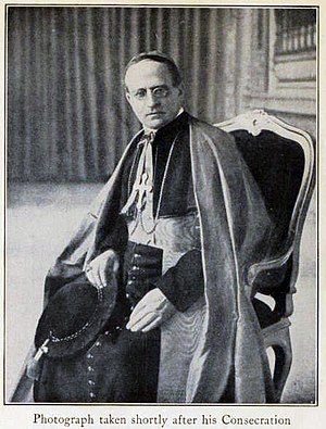 Achille Ratti, shortly after his consecration as bishop Pius XI leaning.jpg