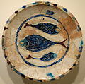Plate with three fish, Lakabi ware, Iran or Syria, Seljuk or Ayyubid period, late 12th or early 13th century, earthenware with carved decoration and blue, brown, and white glazes - Cincinnati Art Museum - DSC03990.JPG
