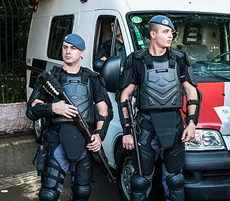 Military Police of São Paulo State - São Paulo Police officers in riot gear .