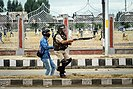 A J&K policeman holding a pellet gun during a violent clash
