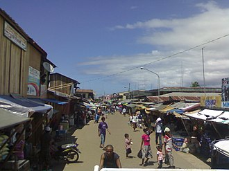 Basilan - Tausug south/southeast: Main road at Port Holland, Maluso, Basilan, flanked by Tausug traders and market stall owners.