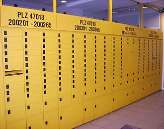 Post-office box - PO boxes of various sizes in a German post office, with their number range and postcodes written above them.