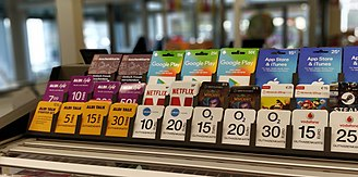 Prepayment for service - Range of prepaid service cards in a German supermarket