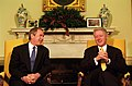 President Bill Clinton and President-Elect George W. Bush hold a meeting in the Oval Office.jpg