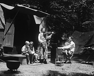 Pete Seeger - Peter Seeger (on father's lap) with his father and mother, Charles and Constance Seeger and brothers on a camping trip (23 May 1921)