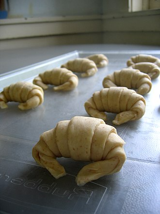 Proofing (baking technique) - Croissants proofing on plastic tray