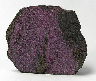 Usakos - Purpurite, a very rare phosphate of manganese, from Sandamab pegmatite,  Usakos,  Namibia. Size: 5.4 x 4.6 x 1.9 cm.