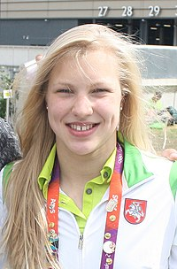 head-and-shoulders photo of smiling blond teenage woman