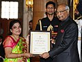 Ram Nath Kovind presenting the Nari Shakti Puruskar for the year 2017 to Ms. Jayamma Bandari, Hyderabad, Telangana, at a function, on the occasion of the International Women's Day, at Rashtrapati Bhavan, in New Delhi.jpg