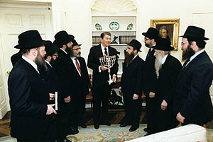 White House Hanukkah Party - President Ronald Reagan receives menorah from the American Friends of Lubavitch, White House, 1984.