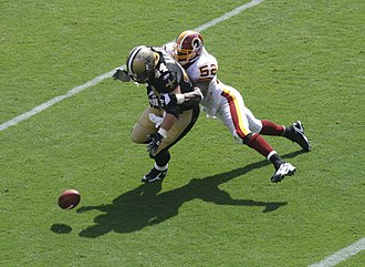 Rocky McIntosh - McIntosh tackling Mike Karney while playing against the Saints in the 2008 season.