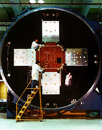Technicians at the Naval Research Laboratory (NRL), work on the Low-powered Atmosphere Compensation Experiment (LACE) satellite.