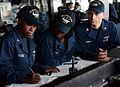 Sailors calculate sunrise at sea. (8390303706).jpg