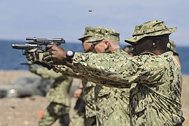 Sailors fire M9 pistols in Djibouti. (11452865983).jpg