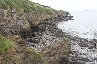 Sand Point and Middle Hope - The cliffs and rocky beach at Middle Hope
