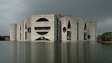 Facade of building across artificial lake