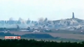 Saur-Mogila bombarded with BM-21 Grad.png