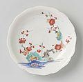 Scalloped saucer with rocks, prunus and bird.jpeg
