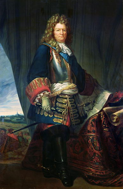 Vauban, avec sa cicatrice ronde sur la joue gauche due à un coup de mousquet reçu lors du siège de Douai. Tableau attribué à une école de peinture du XVIIIesiècle.