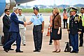 Secretary Kerry chats with Indian Air Force Commodore Kumar after arriving in New Delhi for strategic dialogue.jpg