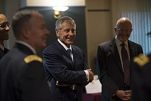 Perjury - Image: Secretary of Defense Chuck Hagel, center, shares a laugh with other guests before a retirement ceremony for U.S. Army Gen. Keith B. Alexander March 28, 2014, at the National Security Agency (NSA) at Fort George 140328 D EV637 372