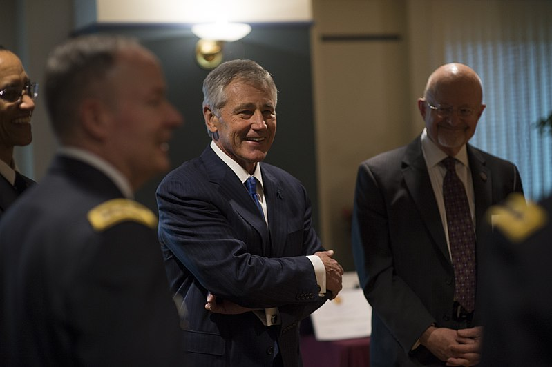 Secretary of Defense Chuck Hagel, center, shares a laugh with other guests before a retirement ceremony for U.S. Army Gen. Keith B. Alexander March 28, 2014, at the National Security Agency (NSA) at Fort George 140328-D-EV637-372.jpg