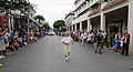 Shirley Ezmirley, center, walks along Duval Street carrying an active-duty portrait of herself from the 1950s during Key West's annual Veterans Day parade in downtown Key West, Fla., Nov. 11, 2013 131111-N-YB753-187.jpg