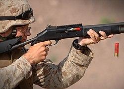A U.S. Marine fires a Benelli M4 shotgun during training in Arta, Djibouti, 23 December 2006.