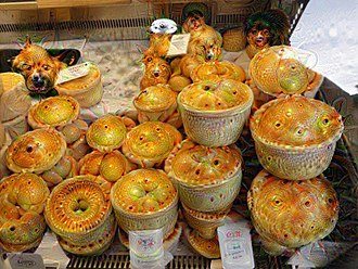 Pareidolia - When passed through the DeepDream program, an image of pies on a market stall shows eyes and the faces of dogs