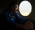 Soyuz TMA-22 crew member Dan Burbank looks out of his helicopter.jpg