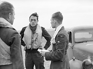Squadron Leader Brian 'Sandy' Lane, CO of No. 19 Squadron (centre) confers with Flight Lieutenant Walter 'Farmer' Lawson and Flight Sergeant George 'Grumpy Unwin at Fowlmere near Duxford, September 1940. CH1366.jpg