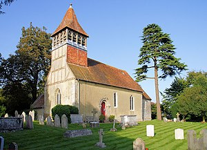 The Barn Church, Kew - The Barn Church's broach spire is copied from the spire at this church near Winchester in Hampshire – St Swithun's Church, Martyr Worthy