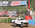Stadium Super Truck 77 Jerrett Brooks takes checkered flag to win Crandon 2013.jpg