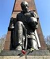 Statue of kneeling Soviet soldier at the Treptow WW2 memorial.jpg