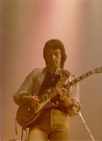 Steve Hackett - Hackett performing with Genesis in 1977